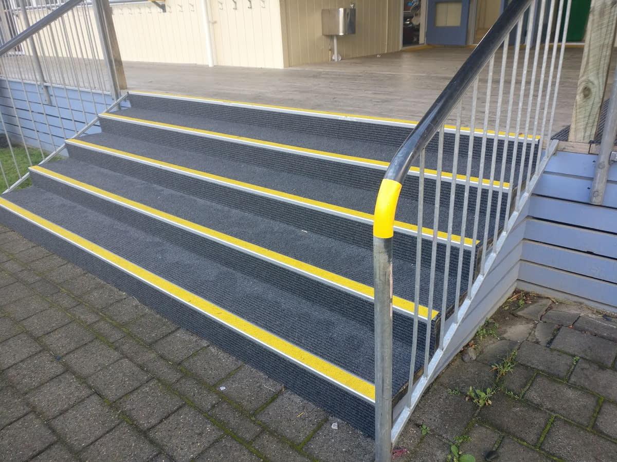 Slim Rib carpet on stairs with yellow stair nosings