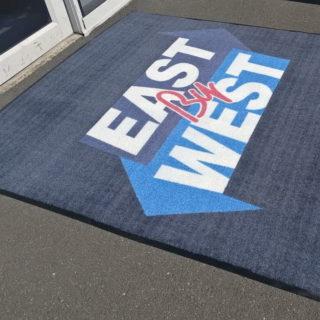 East West logo mat